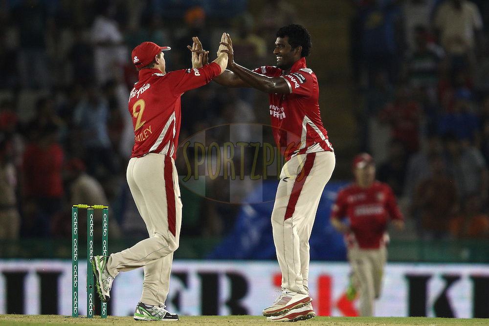 Kings XI Punjab captain George Bailey congratulates Thisara Perera of the Kings XI Punjab for getting Elton Chigumbura of the Barbados Tridents wicket during match 5 of the Oppo Champions League Twenty20 between the Kings XI Punjab and the Barbados Tridents held at the Punjab Cricket Association Stadium, Mohali, India on the 20th September 2014<br /> <br /> Photo by:  Shaun Roy / Sportzpics/ CLT20<br /> <br /> <br /> Image use is subject to the terms and conditions as laid out by the BCCI/ CLT20.  The terms and conditions can be downloaded here:<br /> <br /> http://sportzpics.photoshelter.com/gallery/CLT20-Image-Terms-and-Conditions-2014/G0000IfNJn535VPU/C0000QhhKadWcjYs