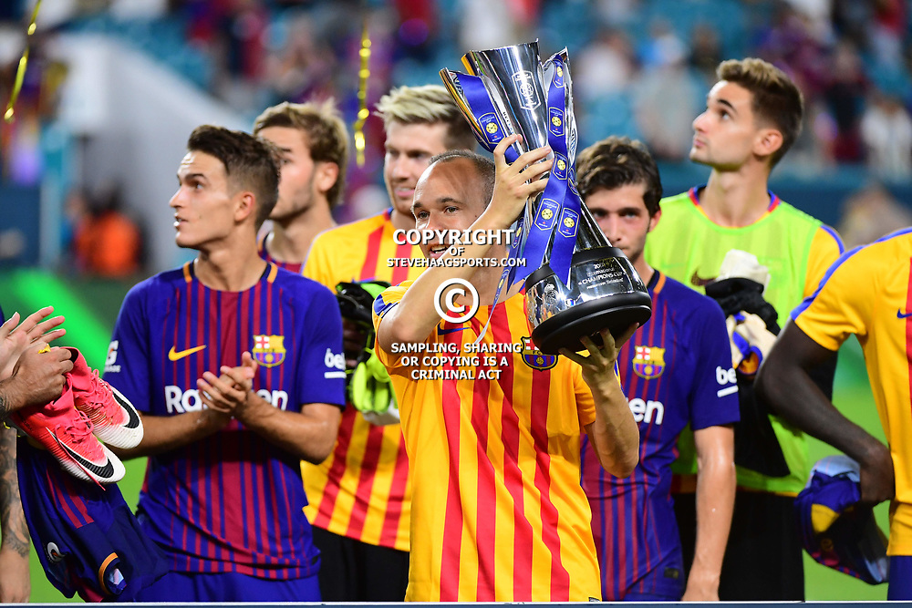Andres Iniesta of Barcelona lifts the tournament winner's trophy after the International Champions Cup match between Barcelona and Real Madrid at Hard Rock Stadium on July 29, 2017 in Miami Gardens, Florida. (Photo by Dave Winter/Icon Sport)