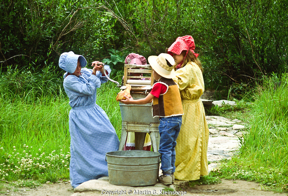 At the Holzwart Homstead, children can dress and play in pioneer clothing.  Rocky Mountain National Park, Colorado.