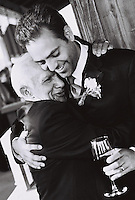 groom & dad or grandfather enjoy a touching but manly hug before getting married