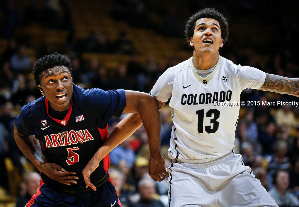 SHOT 2/26/15 9:54:01 PM - Arizona's Stanley Johnson #5 battles Colorado's Dustin Thomas #13 for position on a rebound during their regular season Pac-12 basketball game at the Coors Events Center in Boulder, Co. Arizona won the game 82-54.<br /> (Photo by Marc Piscotty / &copy; 2015)