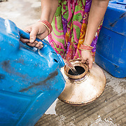 CAPTION: The water collected in community storage tanks has reduced the burden of and time spent on water collection. LOCATION: Devshree Nagar, Indore, Madhya Pradesh, India. INDIVIDUAL(S) PHOTOGRAPHED: N/A.