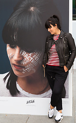 Anna Richardson poses with his portrait at Let's Talk, a photography exhibition created in partnership with Mental Health UK At Regent's Place in London. It is designed to inspire open and honest conversations about mental health by depicting each subjects' inner battles on their faces. . Regents Place, Euston Road, London, October 08 2018.