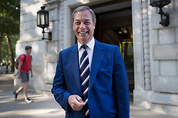 © Licensed to London News Pictures. 16/07/2018. London, UK. Former UKIP party leader Nigel Farage smiles for photographers as he leaves television studios near Parliament. Photo credit: Peter Macdiarmid/LNP
