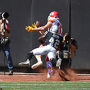 Sep 15, 2019; Oakland, CA, USA; Kansas City Chiefs tight end Travis Kelce (87) catches a touchdown over Oakland Raiders free safety Karl Joseph (42) in the second quarter at Oakland-Alameda County Coliseum. The Chiefs defeated the Raiders 28-10..(Gerome Wright/Image of Sport)