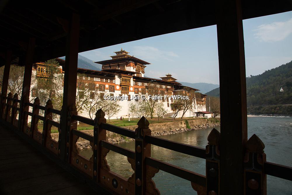 Punakha Dzong from the covered bridge over the Mo Chhu River.  Punakha, Bhutan.