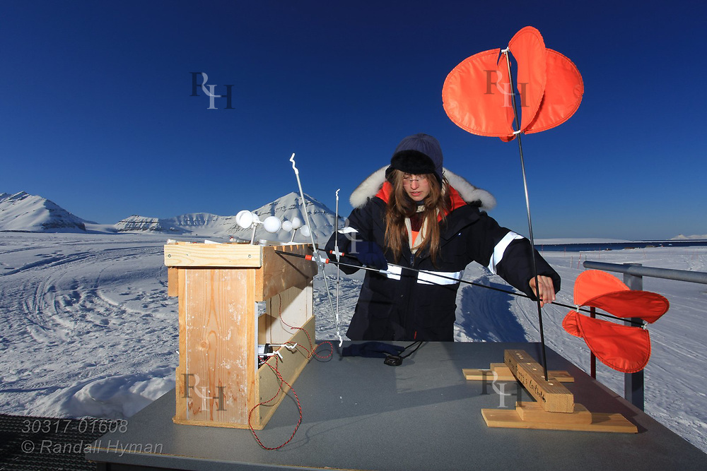 Woman scientist prepares to launch weather instruments on blimp at the French-German AWIPEV research station in the international science village of Ny-Alesund on Spitsbergen island in Kongsfjorden; Svalbard, Norway.