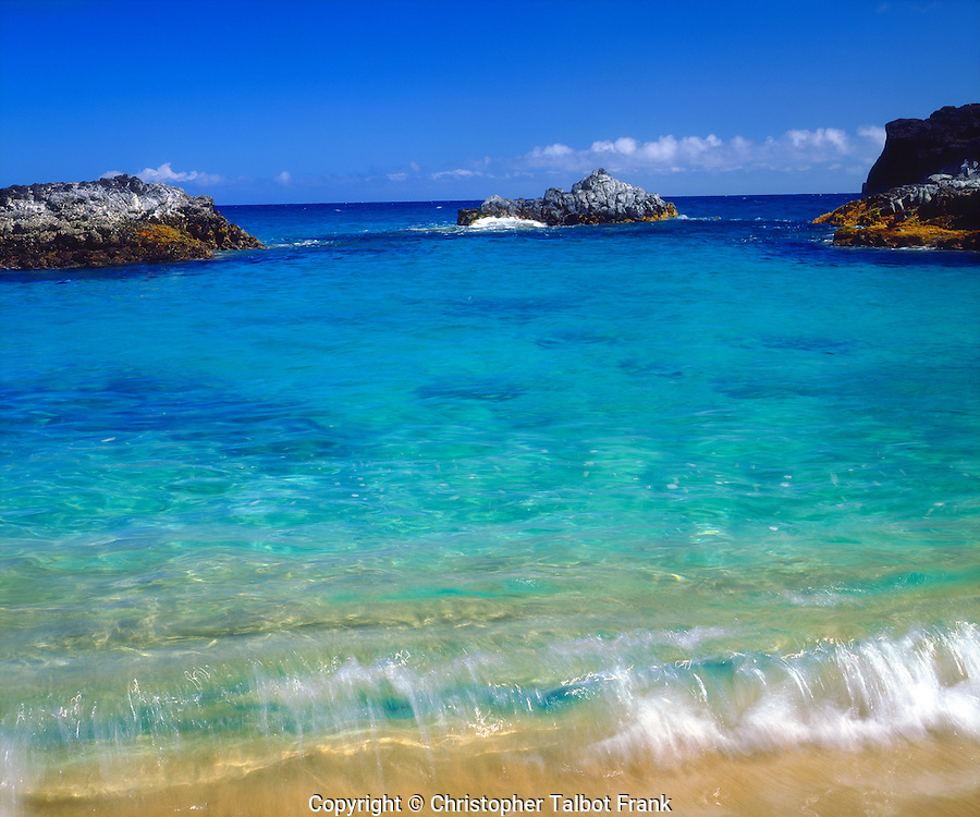 I wanted to capture the inviting waters of Lumahai Beach Kauai in this photo I took which shows so many shades of blue colors from turquoise to deep blue.