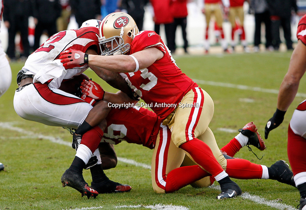 Arizona Cardinals kick returner Andre Roberts (12) gets gang tackled by San Francisco 49ers tight end Colin Cloherty (83) and San Francisco 49ers cornerback Tramaine Brock (26) during the NFL week 17 football game against the San Francisco 49ers on Sunday, January 2, 2011 in San Francisco, California. The 49ers won the game 38-7. (©Paul Anthony Spinelli)