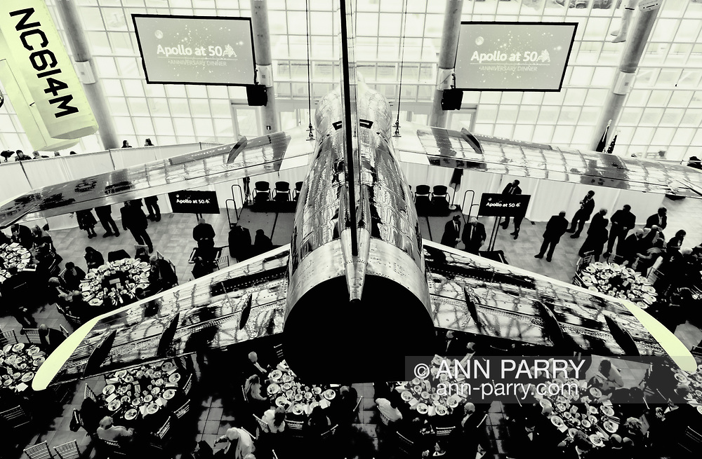 Garden City, New York, USA. June 6, 2019.  Apollo at 50 Anniversary Dinner, an Apollo astronaut tribute celebrating the Apollo 11 mission Moon landing, is seen from second level of atrium. U.S. Navy Blue Angels Grumman F-11A Tiger jet is suspended from ceiling.