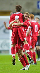 SWANSEA, ENGLAND - Friday, September 4, 2009: Wales' Christian Ribeiro celebrates with man-of-the-match Aaron Ramsey after their 2-1 victory over Italy during the UEFA Under 21 Championship Qualifying Group 3 match at the Liberty Stadium. (Photo by David Rawcliffe/Propaganda)