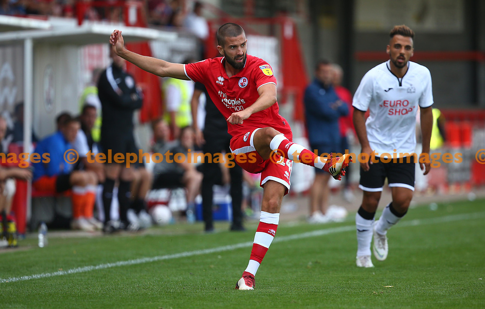 Crawley's George Francomb crosses the ball into the box during the pre season friendly between Crawley Town and KSV Roeselare at The Broadfield Stadium, Crawley , UK. 28 July 2018.