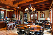 The dining, kitchen and great room inside a home in the 1780 community in Nebo, North Carolina.<br /> <br /> &copy; Photography by Kathy Kmonicek