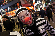 A young Japanese man dressed as a prisoner clown enjoys the Halloween celebrations in Shibuya. Saturday October 28th 2017