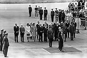 President John F. Kennedy arrives at Dublin Airport.  Kennedy replies to President de Valera's speech of welcome.  Onlookers include President Kennedy's sisters, Mrs. Eunice Shriver and Mrs. Jean Smith; An Taoiseach Seán Lemass; An Tanaiste Mr. Sean McAntee; Dr. James Ryan, Minister for Finance, and Mr. Frank Aiken, Minister for External Affairs..26.06.1963