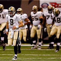 August 27, 2010; New Orleans, LA, USA; New Orleans Saints quarterback Drew Brees (9) runs with teammates prior to kickoff of a preseason game against the San Diego Chargers at the Louisiana Superdome. Mandatory Credit: Derick E. Hingle