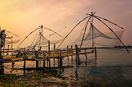 sunset over the famous chinese fishing nets of fort cochi, india