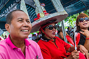 01 MAY 2013 - BANGKOK, THAILAND:   Thai Red Shirts, including a woman wearing a model of Thailand's Democracy Monument as a hat, cheer during the Red Shirt rally and protest at the Constitutional Court in Bangkok. Several hundred Thai Red Shirts, members of the United Front for Democracy against Dictatorship (UDD), have been camped out at Thailand's Constitutional Court, which oversees matters related to the Thai constitution and constitutional amendment. The Red Shirts are protesting the court's decision to consider a petition regarding the constitutionality of the constitutional amendments that have been proposed by the government. The group is arguing that by considering the petition, the Court is impeding the powers of the legislative branch.  PHOTO BY JACK KURTZ