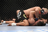"LONDON, ENGLAND, JUNE 7, 2008: Eddie Sanchez (top) lands a puch to the face of Antoni Hardonk during ""UFC 85: Bedlam"" inside the O2 Arena in Greenwich, London on June 7, 2008."