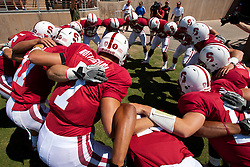 September 3, 2011; Stanford, CA, USA;  Members of the Stanford Cardinal offense huddle before the game against the San Jose State Spartans at Stanford Stadium.  Stanford defeated San Jose State 57-3.