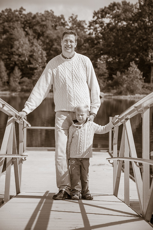 Father and son on dock at Nara Park pond in Acton, MA