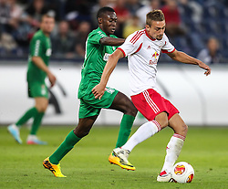 22.08.2013, Red Bull Arena, Salzburg, AUT, UEFA EL Play Off, FC Red Bull Salzburg vs VMFD Zalgiris, Hinspiel, im Bild Komla Nyuiadzi, (VMFD Zalgiris Vilnius, #99) und Stefan Ilsanker, (FC Red Bull Salzburg, #13) // during UEFA Europa League Qualification 1st Leg Match between FC Red Bull Salzburg and VMFD Zalgiris at the Red Bull Arena, Salzburg, Austria on 2013/08/22. EXPA Pictures © 2013, PhotoCredit: EXPA/ Roland Hackl