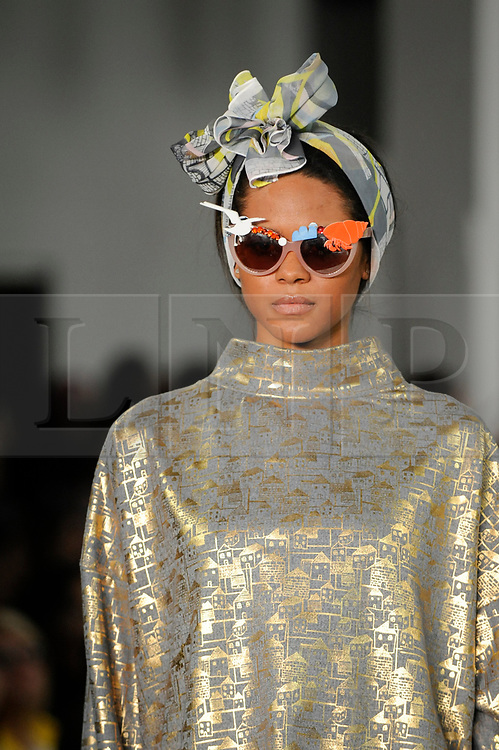 © Licensed to London News Pictures. 07/06/2017. London, UK. A model presents a look during the Best Of catwalk on the final day of Graduate Fashion Week taking place at the Old Truman Brewery in East London.  The event showcases the graduation show of up and coming fashion designers from UK and international universities. Photo credit : Stephen Chung/LNP