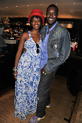 ORLANDO HAMILTON and KHETSIWE GILES-ROWLEY at a party to celebrate the 10th anniversary of the restaurant Sumosan, Albemarle Street, London on 28th May 2012.
