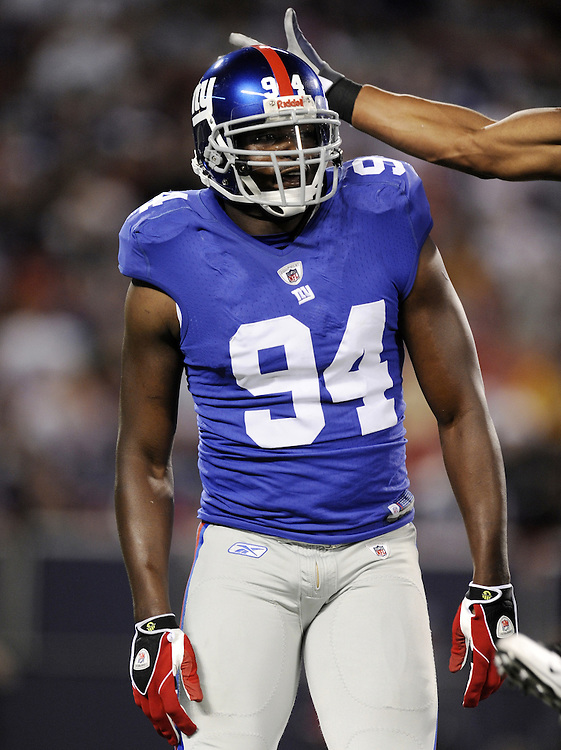 EAST RUTHERFORD, NJ - AUGUST 29: Mathias Kiwanuka #94 of the New York Giants looks on against New York Jets in a preseason game at Giants Stadium on August 29, 2009 in East Rutherford, New Jersey. The New York Jets beat the New York Giants 27-25. (Photo by Rob Tringali) *** Local Caption *** Mathias Kiwanuka