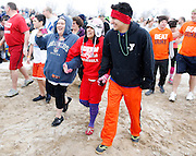 Participants prepare to enter the water at the 14th Annual Polar Bear Plunge at Ontario Beach Park on Sunday, February 9, 2014.