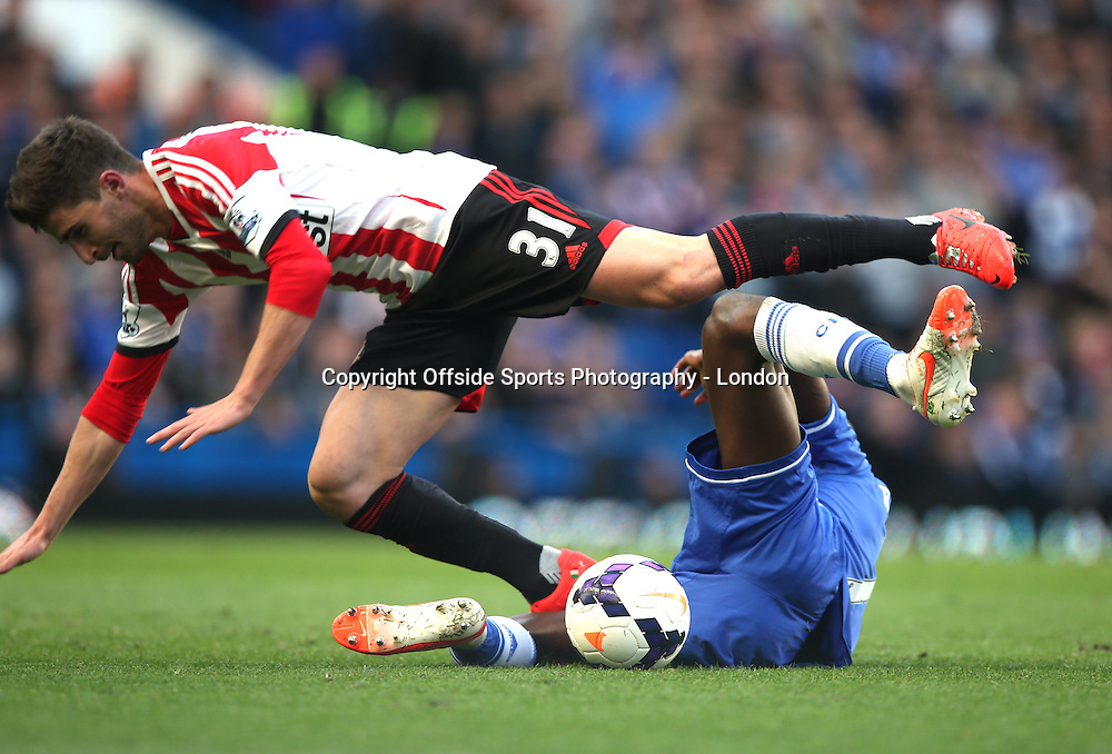 19 April 2014 Premier League Football - Chelsea v Sunderland -<br /> Fabio Borini of Sunderland is tackled by Ramires.<br /> Photo: Mark Leech