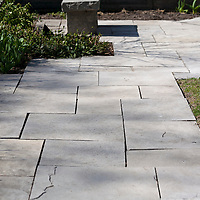 Square-cut flagstone walkway and bench