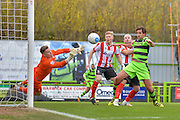 Lincoln City Goalkeeper, Paul Farman (1) makes a save as Forest Green Rovers Midfielder, Darren Carter (12) looks on during the Vanarama National League match between Forest Green Rovers and Lincoln City at the New Lawn, Forest Green, United Kingdom on 19 November 2016. Photo by Adam Rivers.