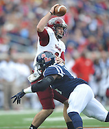 Mississippi linebacker Serderius Bryant (14) sacks Troy quarterback Corey Robinson (6) at Vaught-Hemingway Stadium in Oxford, Miss. on Saturday, November 16, 2013. (AP Photo/Oxford Eagle, Bruce Newman)