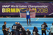 Christian Coleman of the United States of America poses with a flag after winning the Men's 60m final at the IAAF World Indoor Championships day three at the National Indoor Arena, Birmingham, United Kingdom on 3 March 2018. Photo by Martin Cole.