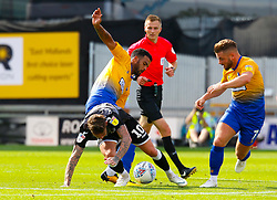 Jacob Mellis of Mansfield Town tackles Sammie Szmodics of Colchester United - Mandatory by-line: Ryan Crockett/JMP - 18/08/2018 - FOOTBALL - One Call Stadium - Mansfield, England - Mansfield Town v Colchester United - Sky Bet League Two