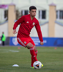 ORHEI, MOLDOVA - Friday, October 11, 2019: Wales' Brennan Johnson during the pre-match warm-up before the UEFA Under-21 Championship Italy 2019 Qualifying Group 9 match between Moldova and Wales at the Orhei District Sports Complex. (Pic by Kunjan Malde/Propaganda)