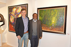 Left to right, singer DAN OLSEN and artist KOLADE OSHINOWO at a private view of the exhibition Transcending Boundaries 2015 held at Lacey Contemporary Gallery, Clarendon Cross, Notting Hill, London on 30th April 2015.