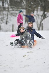 © Licensed to London News Pictures. 20 January 2013. Chipping Norton, Oxfordshire. Jessica Aldworth (20) and Georgie Williams (13). Fun in the snow at Chipping Norton. Photo credit : MarkHemsworth/LNP