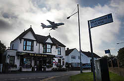 "© Licensed to London News Pictures. 27/10/2016. London, UK. A British Airways Airbus A380 takes off from Heathrow airport over the village of Longford. The government has announced that a third runway will be built at the United Kingdom's busiest airport. The Cabinet are divided - with Foreign Secretary Boris Johnson saying that the project is ""undeliverable"". Conservative MP for Richmond Zac Goldsmith has resigned. Photo credit: Peter Macdiarmid/LNP"