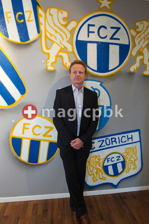 Rolf FRINGER poses in front of a wall with several FCZ logos after being presented as new head coach of Swiss National League A soccer club FC Zuerich at the club's museum in Zurich, Switzerland, Friday, March 30, 2012. (Photo by Patrick B. Kraemer / MAGICPBK)
