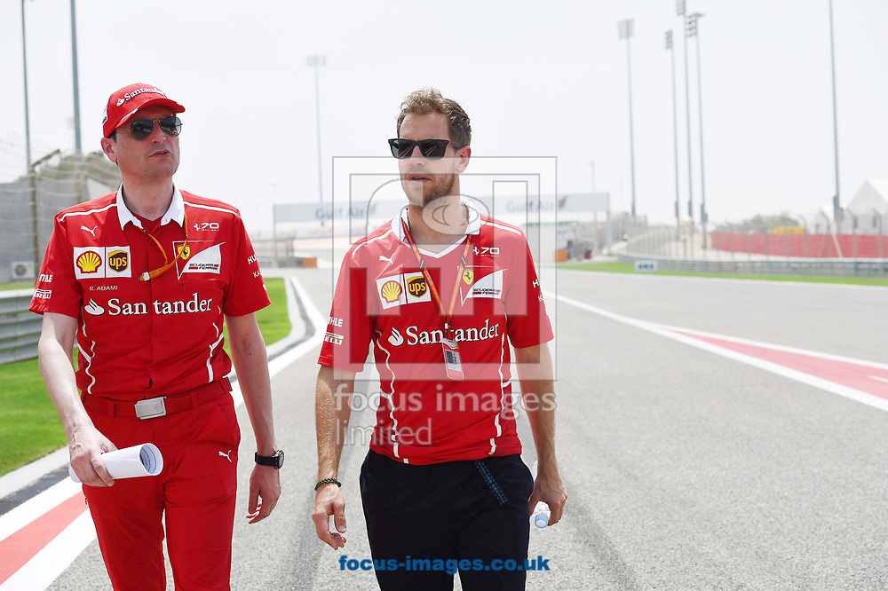 Sebastian Vettel of Scuderia Ferrari walks the circuit with racing engineer Riccardo  Adami die Strecke during the Bahrain Formula One Grand Prix Preparations at the International Circuit, Sakhir<br /> Picture by EXPA Pictures/Focus Images Ltd 07814482222<br /> 13/04/2017<br /> *** UK &amp; IRELAND ONLY ***<br /> <br /> EXPA-EIB-170413-0083.jpg