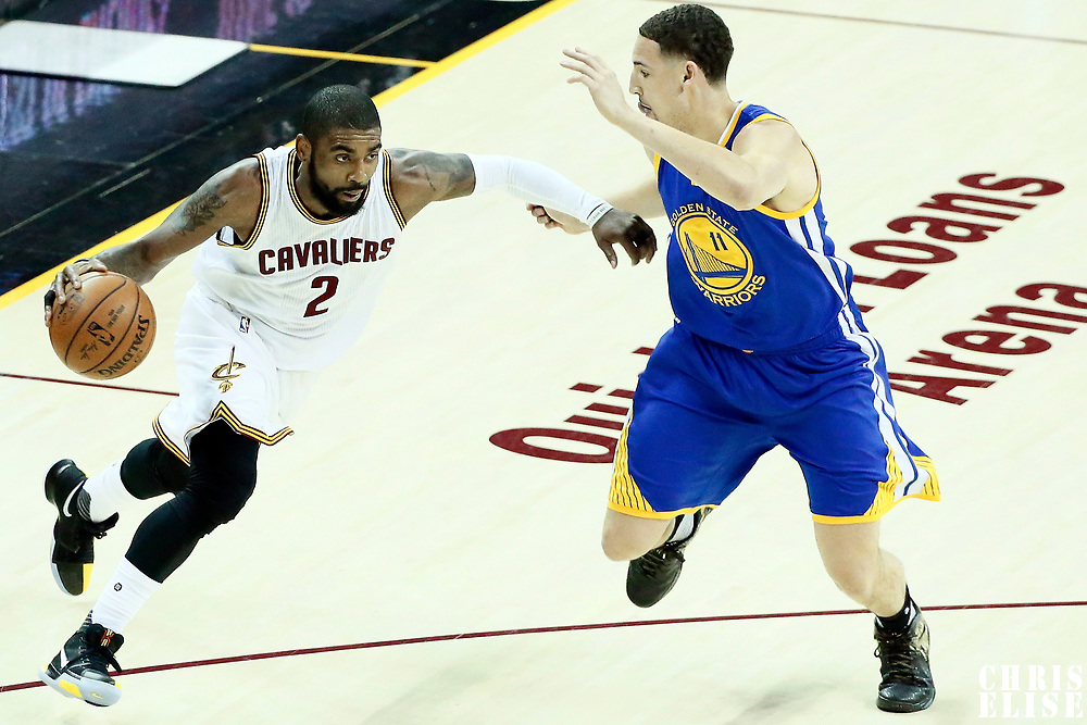 07 June 2017: Cleveland Cavaliers guard Kyrie Irving (2) drives past Golden State Warriors guard Klay Thompson (11) during the Golden State Warriors 118-113 victory over the Cleveland Cavaliers, in game 3 of the 2017 NBA Finals, at  the Quicken Loans Arena, Cleveland, Ohio, USA.