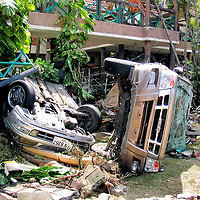 Overturned Cars After Tsunami on Patong Beach in Phuket, Thailand <br />