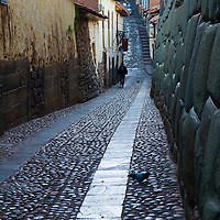 Old narrow street in the center of Cusco Peru