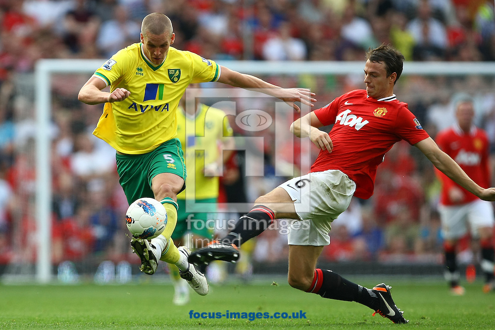 Picture by Paul Chesterton/Focus Images Ltd.  07904 640267.1/10/11.Steve Morison of Norwich and Jonny Evans of Man Utd in action during the Barclays Premier League match at Old Trafford Stadium, Manchester.