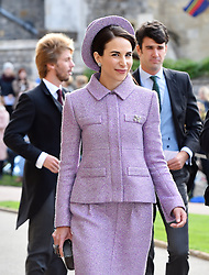 A guest arrives for the wedding of Princess Eugenie to Jack Brooksbank at St George's Chapel in Windsor Castle