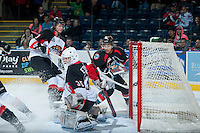 KELOWNA, CANADA - OCTOBER 19: Ty Edmonds #35 of the Prince George Cougars makes a save on a shot from Tyrell Goulbourne #12 of the Kelowna Rockets on October 19, 2013 at Prospera Place in Kelowna, British Columbia, Canada.   (Photo by Marissa Baecker/Shoot the Breeze)  ***  Local Caption  ***