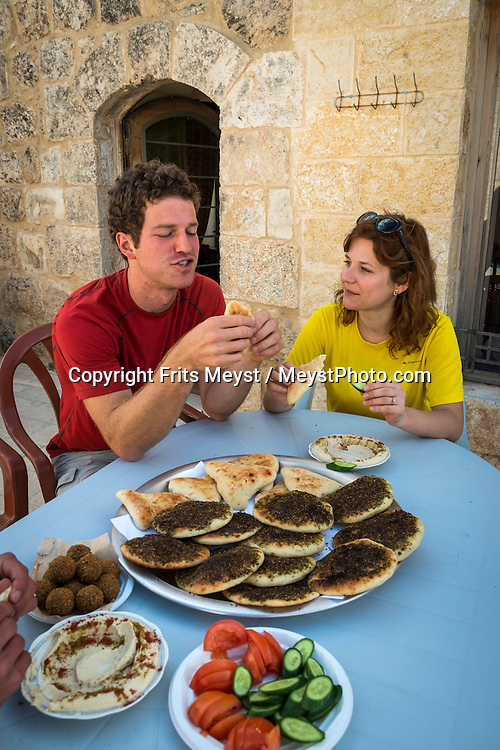 Sebastia, Palestine, March 2015. Breakfast and overnight at the restored historical building of the Sebastia Guesthouse. The historical town centre of SebastiaThe Abraham Path is a long-distance walking trail across the Middle East which connects the sites visited by the patriarch Abraham. The trail passes through sites of Abrahamic history, varied landscapes, and a myriad of communities of different faiths and cultures, which reflect the rich diversity of the Middle East. Photo by Frits Meyst / MeystPhoto.com for AbrahamPath.org