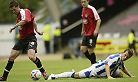 Photo: Aidan Ellis.<br /> Huddersfield Town v Bristol City. Coca Cola League 1. 12/08/2006.<br /> Bristol's Jamie McAllister nicks the ball away from Huddersfield's Andrew Holdsworth